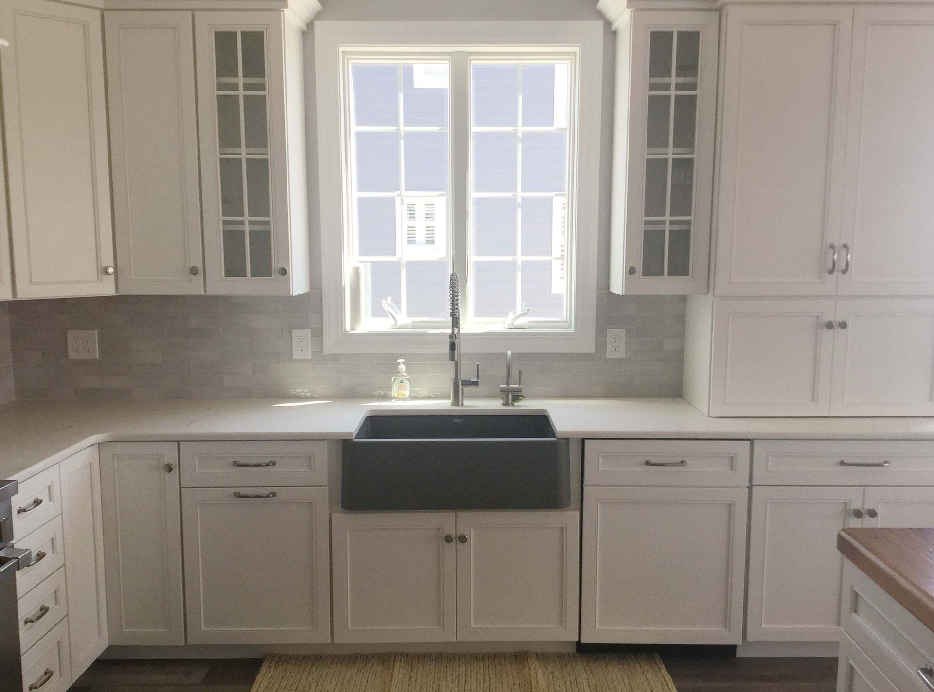 White custom cabinets and window
